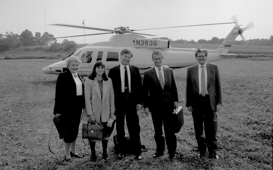 During his extensive career with GE, Denis Nayden '76, '77 MBA (second from right) frequently came to speak on campus, often flying in on the company's helicopter. With Denis are the School's former director of MBA career services, Pat Mochel (far left) and Dick Kochanek, former associate dean and accounting professor (far right). (UConn School of Business)