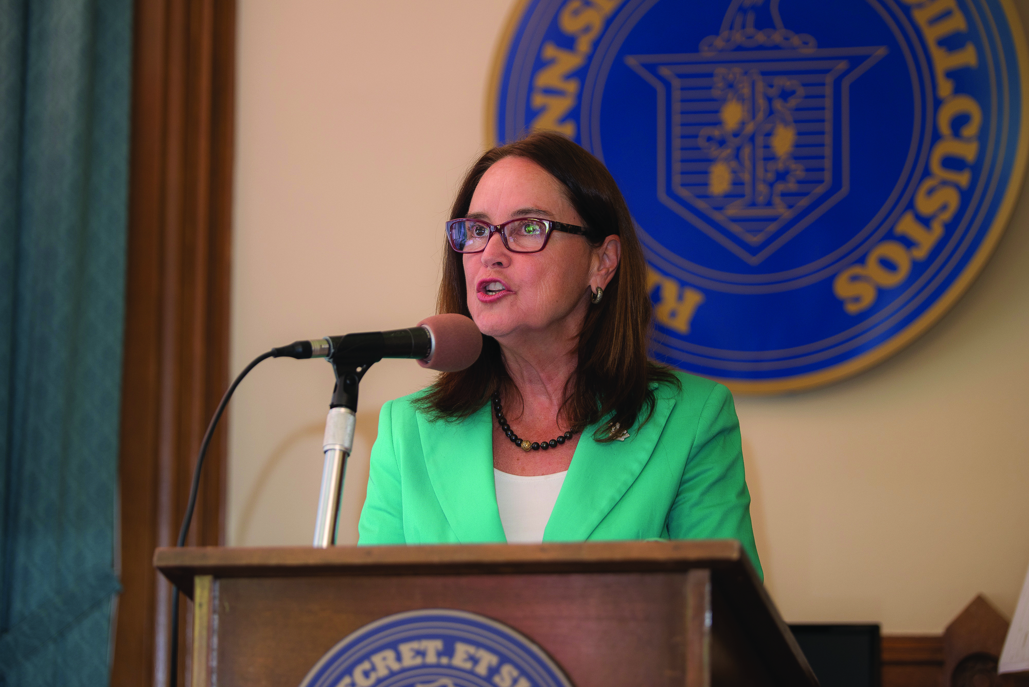 Secretary of the State Denise Merrill addresses the media at a September 2015 press conference announcing the partnership with the School of Business to deliver mandated training to the State's 338 Registrars of Voters.
