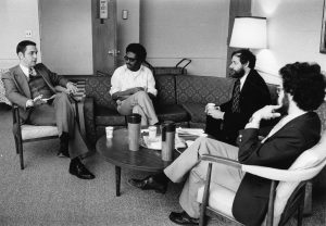 Dean Ronald Patten (left) talks with professors including Mo Hussein (2nd from left) in November 1978.