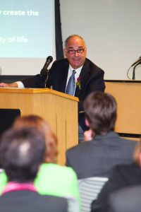 Ed Satell '57 delivers a lecture on corporate social responsibility in October 2014.