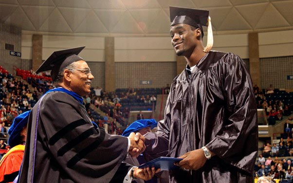 Emeka Okafor receives his diploma from former School of Business Dean Curt Hunter during Commencement ceremonies at Gampel Pavilion in May 2004. ( Ryan McKee/NCAA Photos)